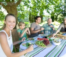 84753062-portrait-of-family-having-lunch-outdoors-gettyimages